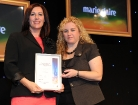 Photo of Laurie McDonald accepting Finalist's Certificate