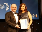 Photo of Laurie McDonald accepting the Finalists Certificate at the Telstra 2011 ACT Business Awards