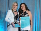 Photo of Laurie McDonald receiving the Telstra 2013 ACT Micro Business Winner Award from Karen Nicholas of Learning Options